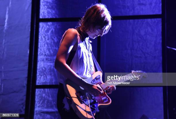 Emily Kokal of Warpaint performs during the 'Global Spirit Tour' at ORACLE Arena on October 10 2017 in Oakland California