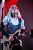 Emily Kokal of Warpaint performs on stage at Open'er Festival at Gdynia Kosakowo Airport on July 5 2014 in Gdynia Poland
