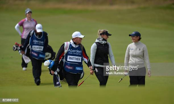 Emily Kristine Pedersen of Denmark and Catriona Matthew of Scotland share a joke as they walk to the 9th green together during the second day of the...