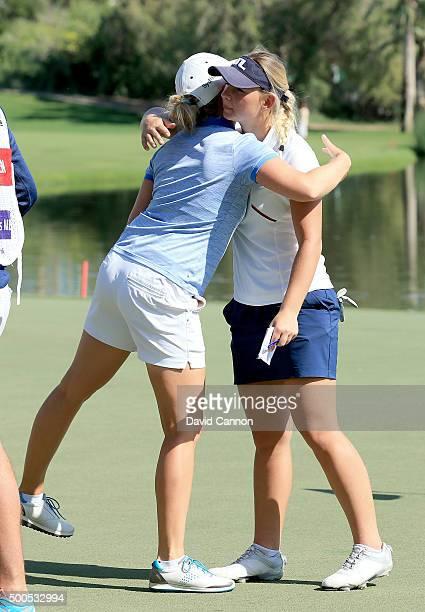 Emily Kristine Pedersen of Denmark embraces her playing partner Nana Koerstz Madsen of Denmark on the green at the par 4 9th green during the first...