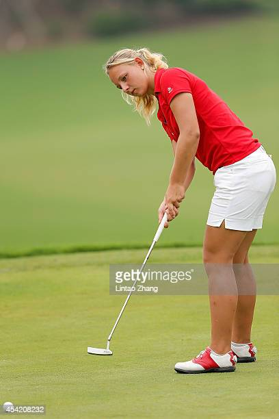 Emily Kristine Pedersen of Denmark plays a shot during the Mixed Team on day ten of the Nanjing 2014 Summer Youth Olympic Games at at Zhongshan...