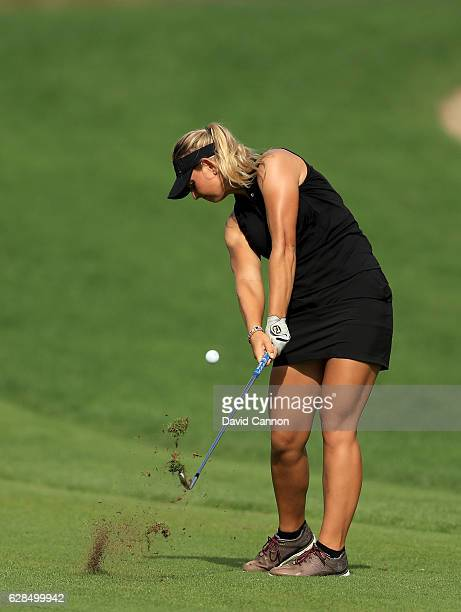 Emily Kristine Pedersen of Denmark plays her second shot on the 14th hole during the completion of the first round of the 2016 Omega Dubai Ladies...