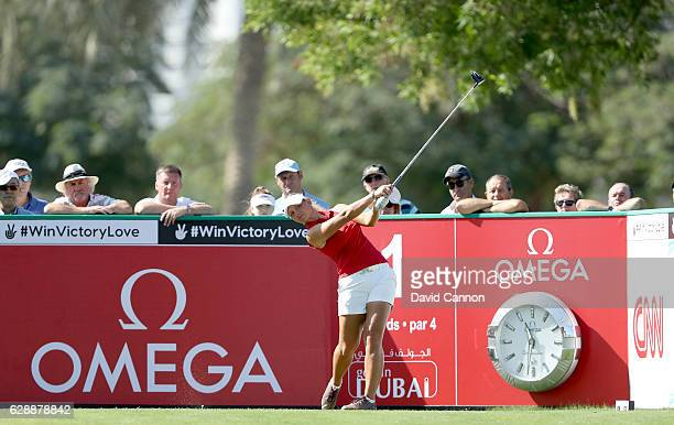 Emily Kristine Pedersen of Denmark plays her tee shot on the first hole during the final round of the 2016 Omega Dubai Ladies Masters on the Majlis...
