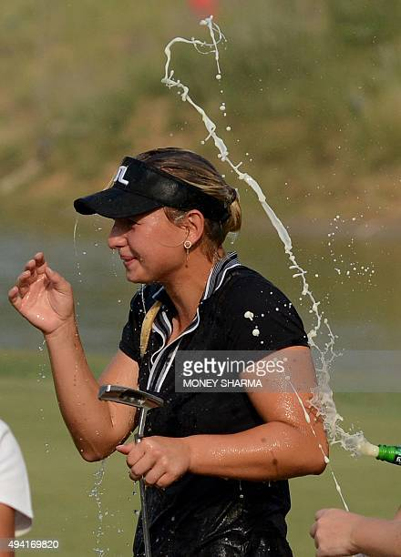 Emily Kristine Pedersen of Denmark reacts after winning the women's Indian Open golf tournament in Gurgaon on the outskirts of New Delhi on October...