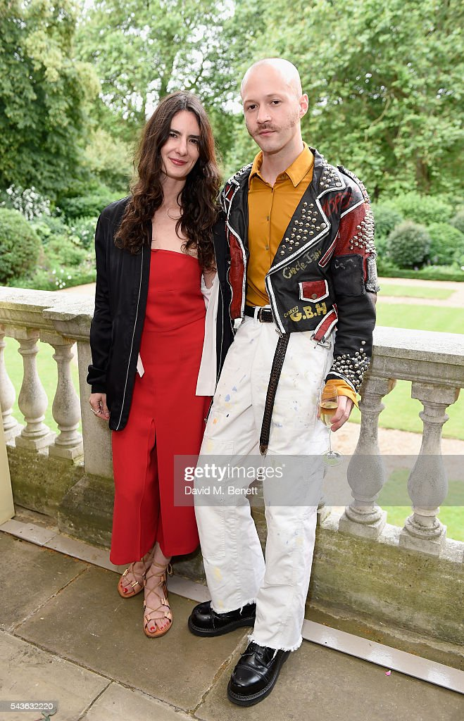 Emily Kroll and Michael Walls attend the Creatures of the Wind Resort 2017 collection and runway show presented by Farfetch at Spencer House on June 29, 2016 in London, England.
