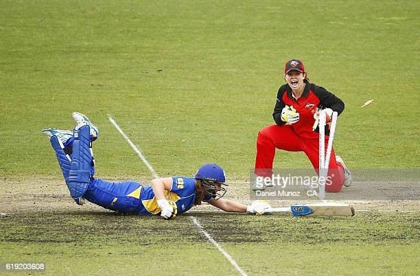 Emily Leys of the Meteors makes her ground during the WNCL match between ACT and South Australia at Manuka Oval on October 29 2016 in Canberra...