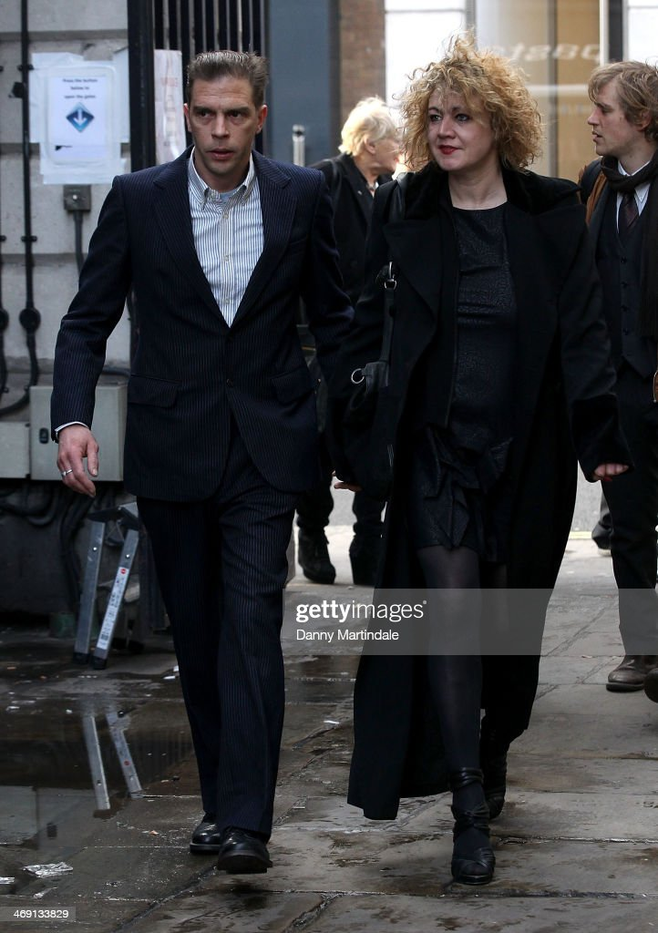 Emily Lloyd (R), daughter of Roger Lloyd-Pack and friend attends the funeral of actor Roger Lloyd-Pack at St Paul's Church on February 13, 2014 in London, England.