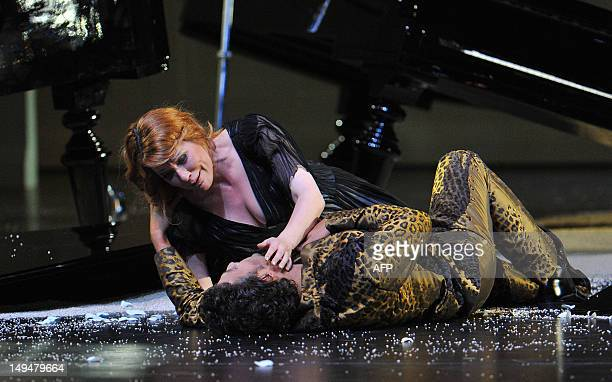 Emily Magee as Ariadne and Jonas Kaufmann as Bacchus perform on stage during a dress rehearsal of Richard Strauss' opera 'Ariadne auf Naxos' in...