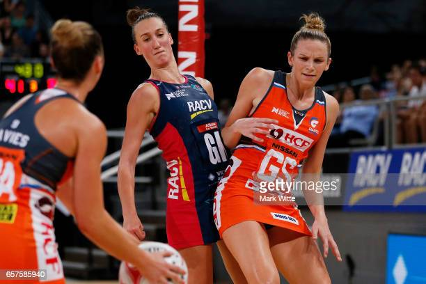 Emily Mannix of Melbourne Vixens gets sholdered by Jo Harten of Giants Netball during the round six Super Netball match between the Vixens and the...