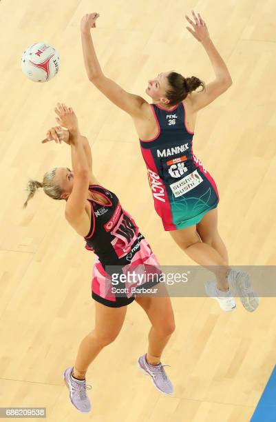 Emily Mannix of the Vixens and Chelsea Pitman of the Thunderbirds compete for the ball during the round 13 Super Netball match between the Vixens and...