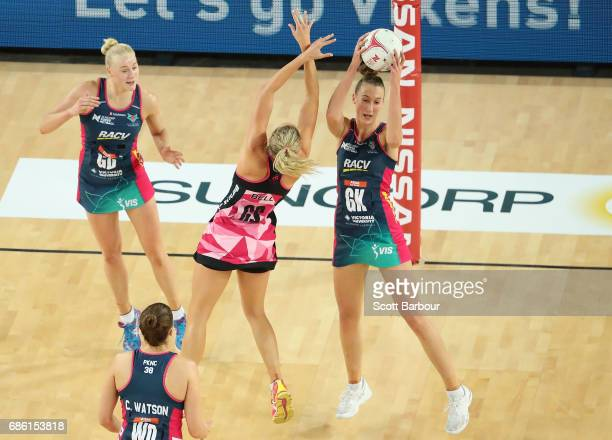 Emily Mannix of the Vixens and Erin Bell of the Thunderbirds compete for the ball during the round 13 Super Netball match between the Vixens and the...