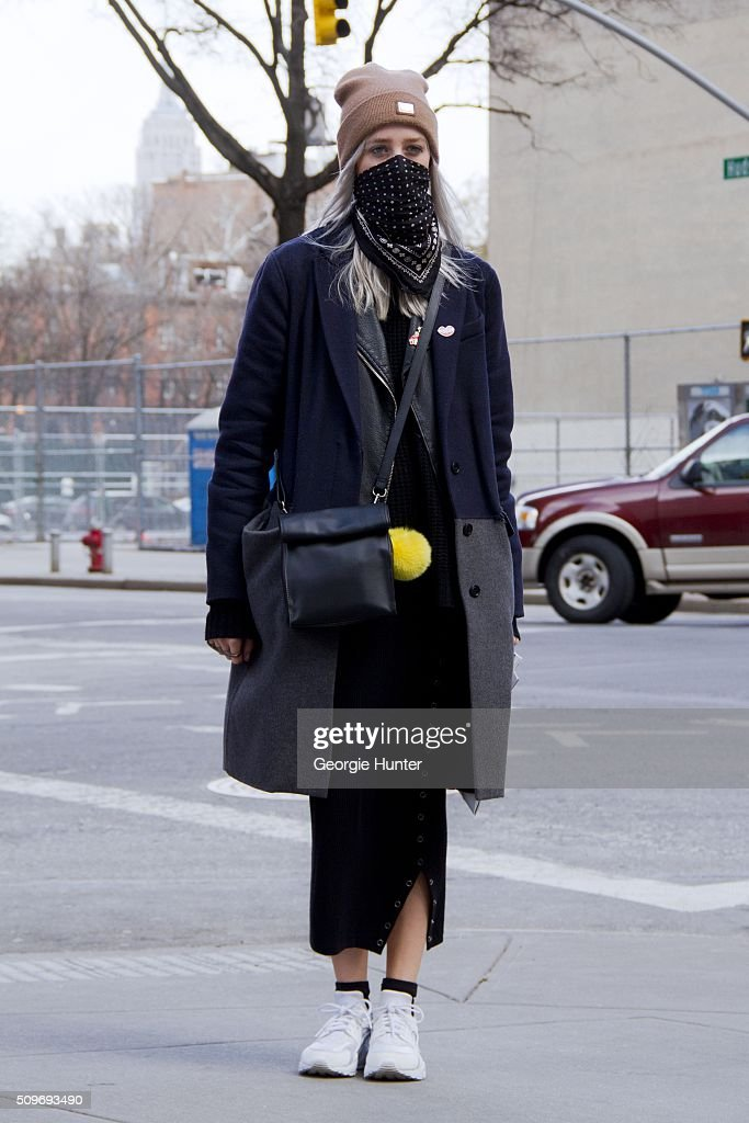 Emily Mercer seen at Skylight Clarkson Sq. outside the Erin Fetherston show wearing Theory coat, Supreme beanie hat, Coach scarf, black leather thrifed bag with yellow pom pom, Levi's sweater and skirt and white Nike sneakers during New York Fashion Week: Women's Fall/Winter 2016 on February 11, 2016 in New York City.