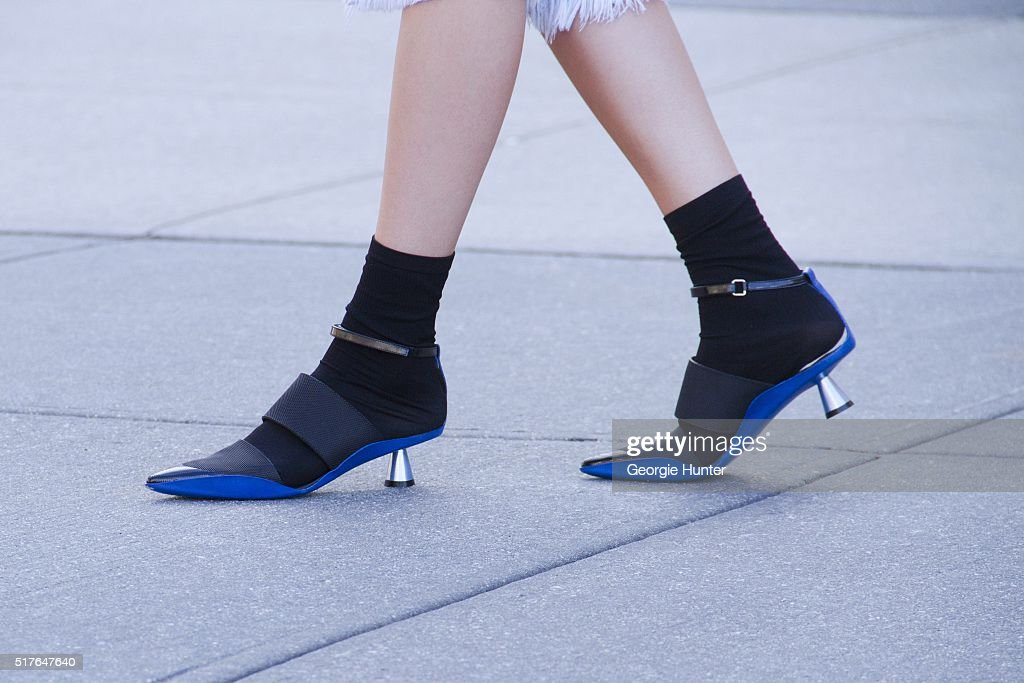 Emily Mercer wearing black and blue Kenzo shoes and black socks by Stance on March 26, 2016 in New York City.