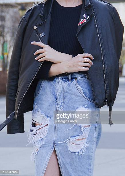 Emily Mercer wearing high waisted ripped One Teaspoon denim skirt Rag Bone navy sweater right hand rings by Zoe Chicco Michelle Fantaci Nayla Arida...