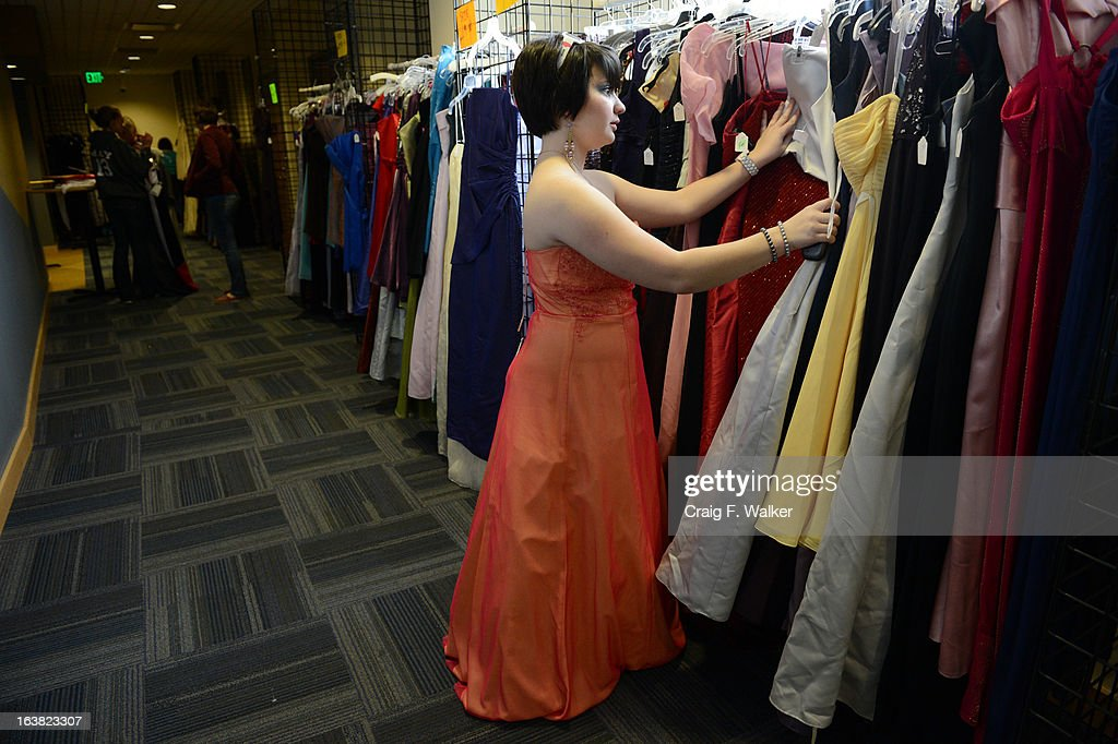 Emily Moreno, 17, of Thornton, looks through the selection while trying on dresses at the Prom Dress Exchange Corp. event in Commerce City, CO March 16, 2013. With a valid student ID and a suggested $10 donation, teenage girls could chose from 1,356 donated dresses that lined a long hallway at Dick's Sporting Goods Park. Moreno, who does her schooling online, said she needs a dress because she plans on attending four proms with friends.