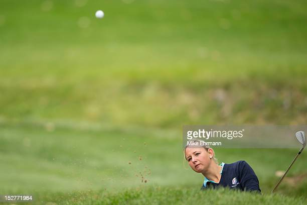 Emily Pedersen of Denmark from the European Team chips a shot out of the bunker on the second hole during the morning singles for the 8th Junior...
