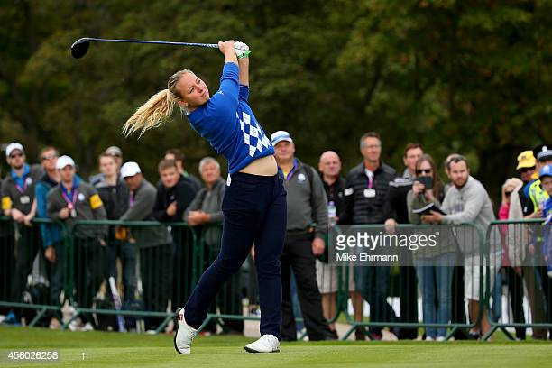 Emily Pedersen of Team Europe hits a tee shot during the Friendship Match ahead of the 2014 Ryder Cup on the PGA Centenary course at the Gleneagles...