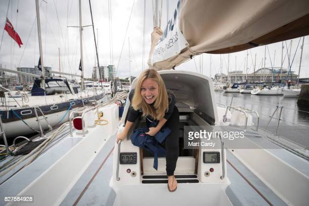 Emily Penn cofounder of eXXpedition climbs from below deck of the yacht Sea Dragon as the crew prepare to sail around Britain to highlight plastic in...