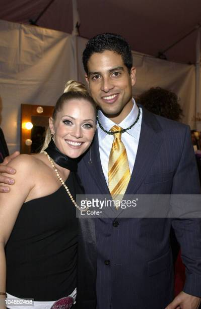 Emily Procter wearing a Gemisphere necklace and Adam Rodriguez also wearing a Gemisphere necklace at the 2003 People's Choice Awards Backstage...