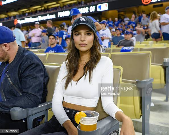 Emily Ratajkowski attends game 5 of the NLCS between the Chicago Cubs and the Los Angeles Dodgers at Dodger Stadium on October 20 2016 in Los Angeles...