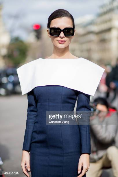 Emily Ratajkowski wearing a navy dress outside Miu Miu on March 7 2017 in Paris France