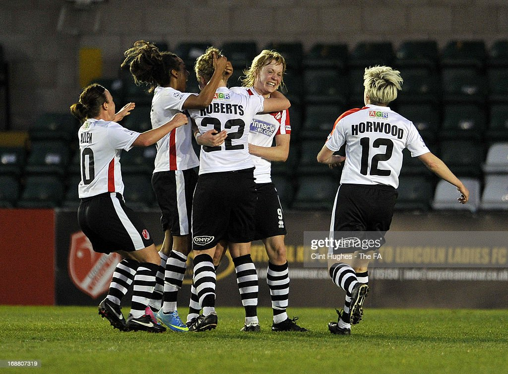 Emily Roberts (no 22) of Lincoln Ladies celebrates with her team-mates after scoring the first goal of the game for her side during the FA WSL match between Lincoln Ladies FC and Arsenal Ladies FC at the Sincil Bank Stadium on May 15, 2013 in Lincoln, England