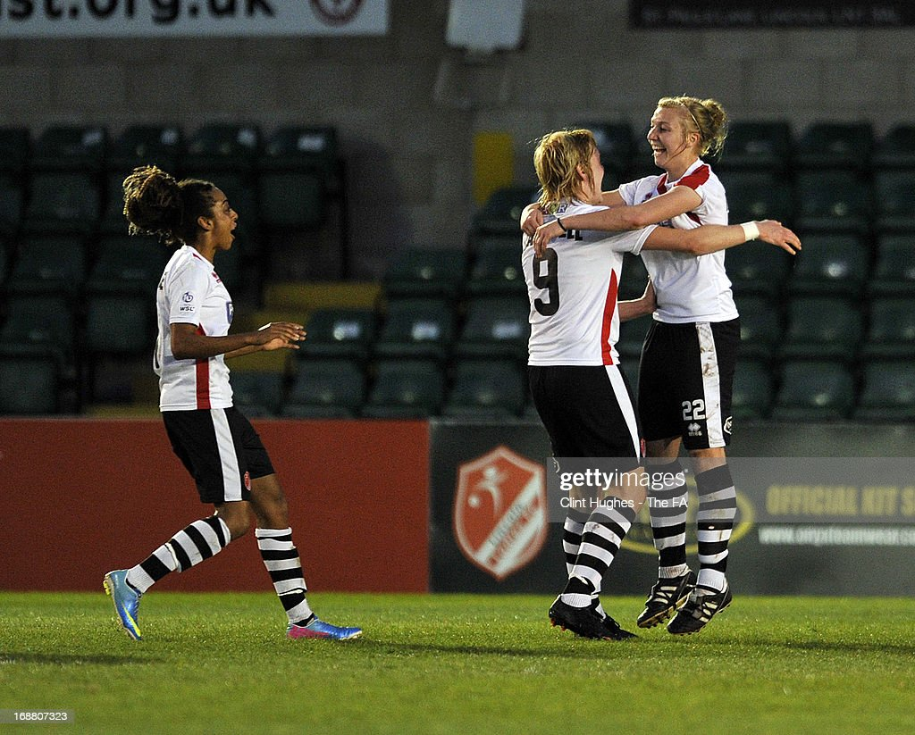 Emily Roberts (right) of Lincoln Ladies celebrates with her team-mates after scoring the first goal of the game for her side during the FA WSL match between Lincoln Ladies FC and Arsenal Ladies FC at the Sincil Bank Stadium on May 15, 2013 in Lincoln, England