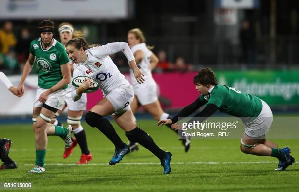 Emily Scarratt of England hands off Ciara Griffin of Ireland during the Women's Six Nations match between Ireland and England at Donnybrook Stadium...