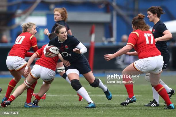 Emily Scarratt of England is challenged by Cerys Hale of Wales during the Womens Six Nations match between Wales and England at the Cardiff Arms Park...