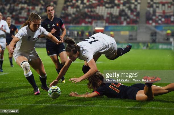 Emily Scarratt of England is denied a try by Elodie Guiglion of France during the Womens Rugby World Cup semifinal between England and France at the...