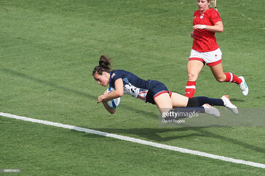 Emily Scarratt of Great Britain dives to score a try against Canada during Women's Pool C rugby match on Day 2 of the Rio 2016 Olympic Games at...