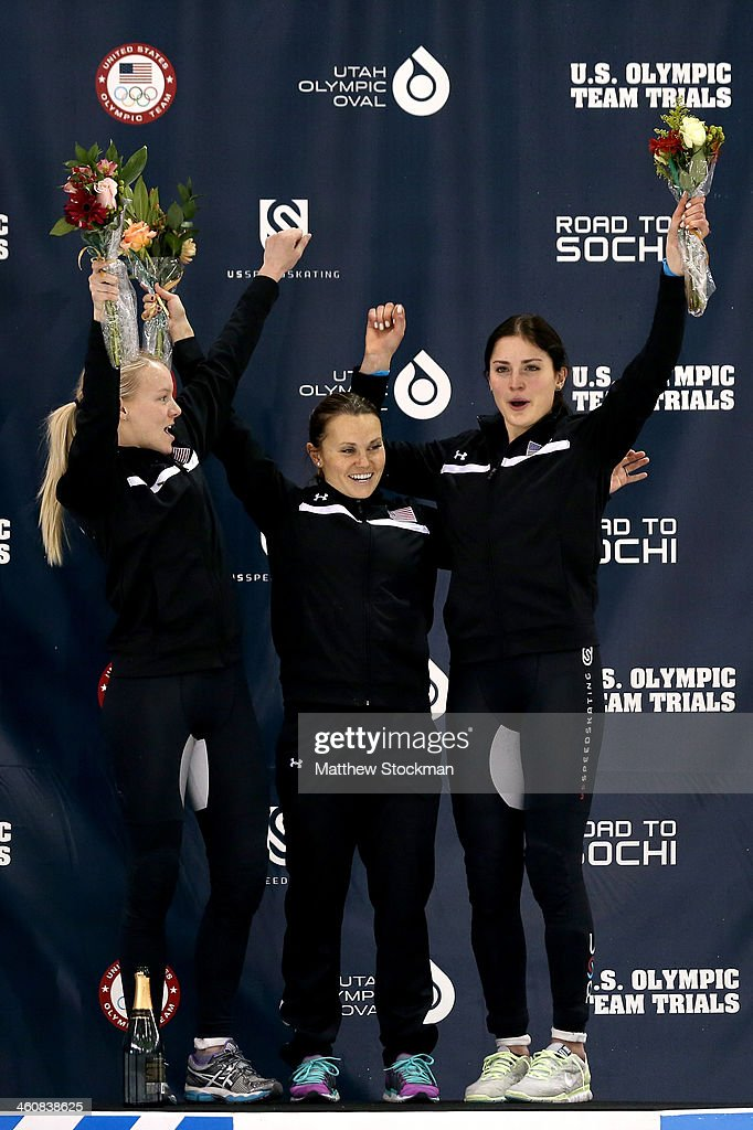 <a gi-track='captionPersonalityLinkClicked' href=/galleries/search?phrase=Emily+Scott+-+Speed+Skater&family=editorial&specificpeople=15291931 ng-click='$event.stopPropagation()'>Emily Scott</a>, Jessica Smith and <a gi-track='captionPersonalityLinkClicked' href=/galleries/search?phrase=Alyson+Dudek&family=editorial&specificpeople=5581264 ng-click='$event.stopPropagation()'>Alyson Dudek</a> celebrate on the medals podium after ladies 1,000 meter final during the U.S. Olympic Short Track Trials at the Utah Olympic Oval on January 5, 2014 in Salt Lake City, Utah.