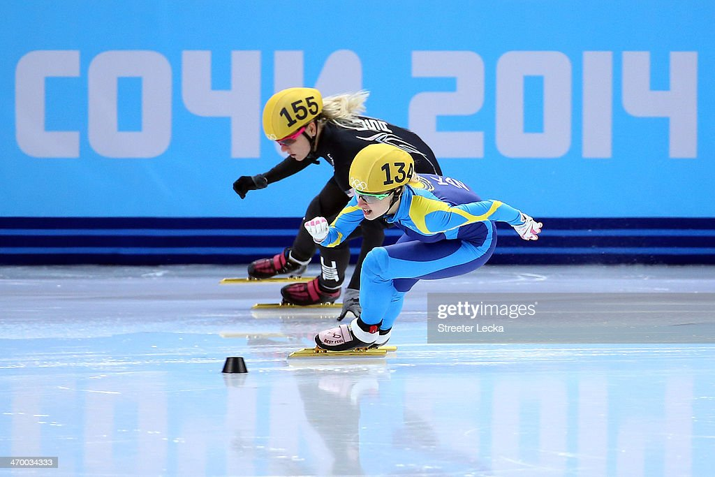 <a gi-track='captionPersonalityLinkClicked' href=/galleries/search?phrase=Emily+Scott+-+Speed+Skater&family=editorial&specificpeople=15291931 ng-click='$event.stopPropagation()'>Emily Scott</a> of the United States and Inna Simonova of Kazakhstan compete in the Short Track Ladies' 1000m Heat at Iceberg Skating Palace on day 11 of the 2014 Sochi Winter Olympics on February 18, 2014 in Sochi, Russia.
