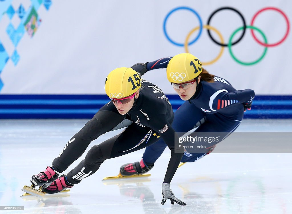 <a gi-track='captionPersonalityLinkClicked' href=/galleries/search?phrase=Emily+Scott+-+Speed+Skater&family=editorial&specificpeople=15291931 ng-click='$event.stopPropagation()'>Emily Scott</a> of the United States and Seung-Hi Park of South Korea compete in the Short Track Speed Skating Ladies' 500m heats on day 3 of the Sochi 2014 Winter Olympics at Iceberg Skating Palace on February 10, 2014 in Sochi, Russia.