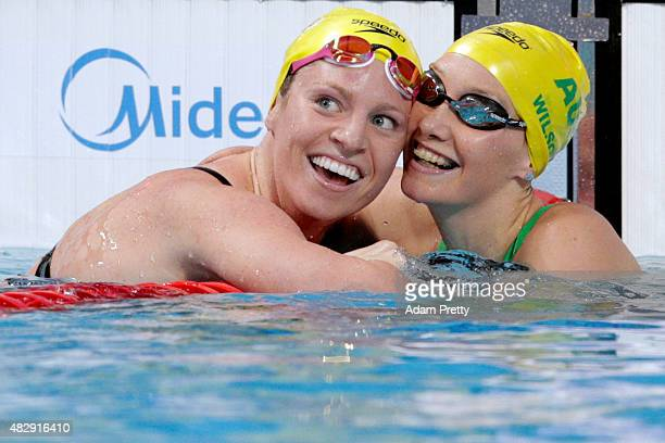Emily Seebohm of Australia celebrates winning the gold medal with silver medallist Madison Wilson of Australia in the Women's 100m Backstroke Final...