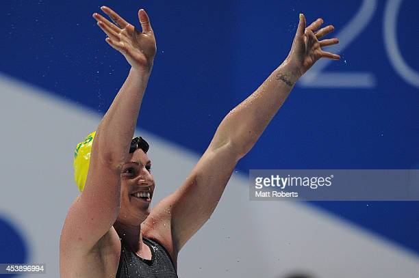 Emily Seebohm of Australia celebrates winning the Women's 100m Backstroke final during day one of the 2014 Pan Pacific Championships at Gold Coast...