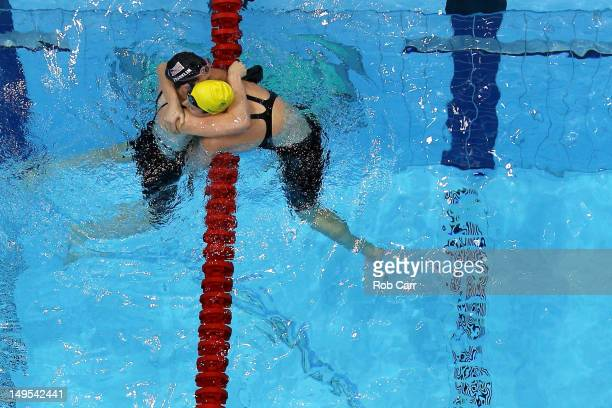 Emily Seebohm of Australia congratulates Missy Franklin of the United States after Franklin won the Final of the Women's 100m Backstroke on Day 3 of...