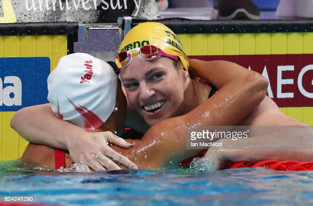 Emily Seebohm of Australia reacts with Kylie Masse of Canada after wining the Women's 200m Backstroke final during the FINA World Championships at...