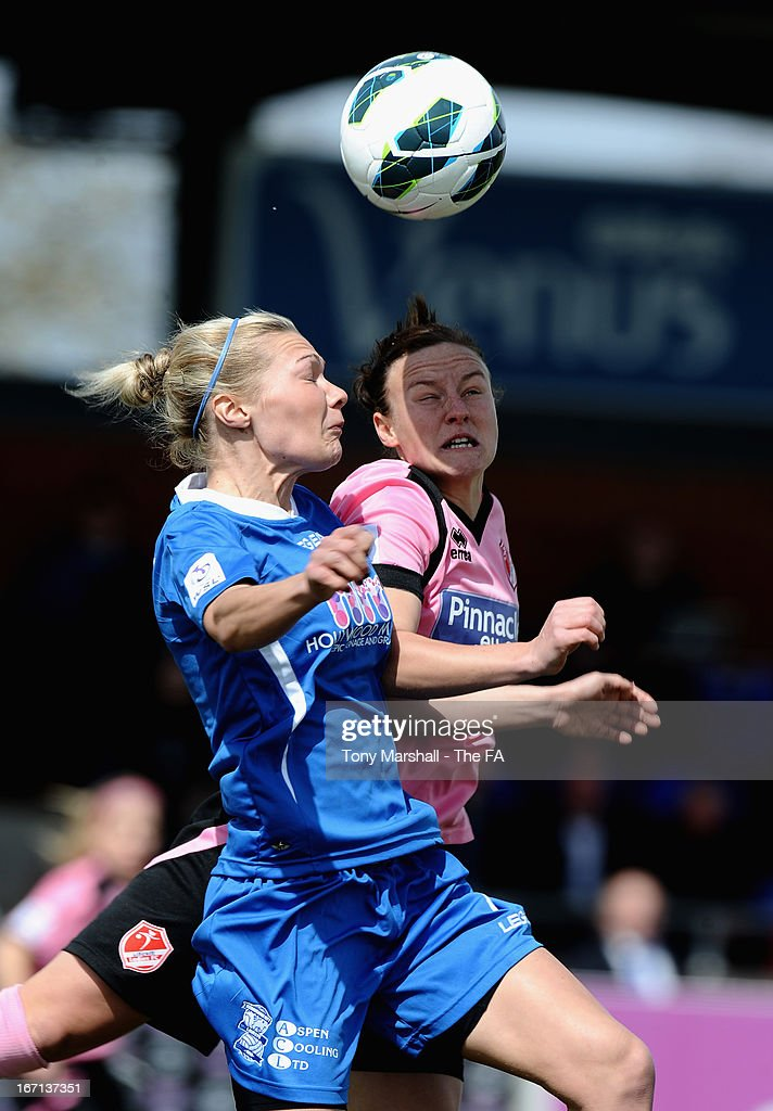 Emily Simpkins of Birmingham City (L) and Remi Allen of Lincoln Ladies compete for a header during the FA Women's Super League match between Birmingham City Ladies FC and Lincoln Ladies FC at DCS Stadium, Stratford Town FC on April 21, 2013 in Stratford, England.