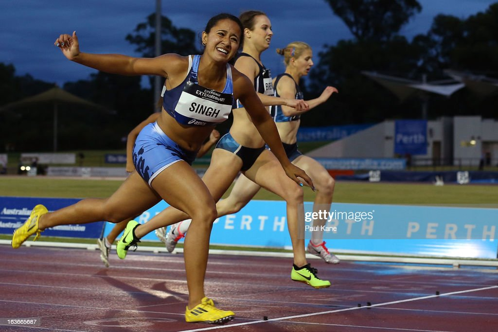 Emily Singh of New South Wales lunges at the line to win the women's u20 200 metre final during day three of the Australian Junior Championships at the WA Athletics Stadium on March 14, 2013 in Perth, Australia.