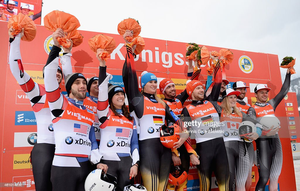 Emily Sweeney, Chris Mazdzer, Matthew Mortensen and Jayson Terdiman of the United States, Natalie Geisenberger, Felix Loch, Tobias Wendl and Tobias Arlt of Germany and Alex Gough, Samuel Edney, Tristan Walker and Justin Snith of Canada pose at the podium after the FIL Luge Team Relay World Cup Koenigssee at Deutsche Post Eisarena on January 4, 2015 in Koenigssee, Germany.
