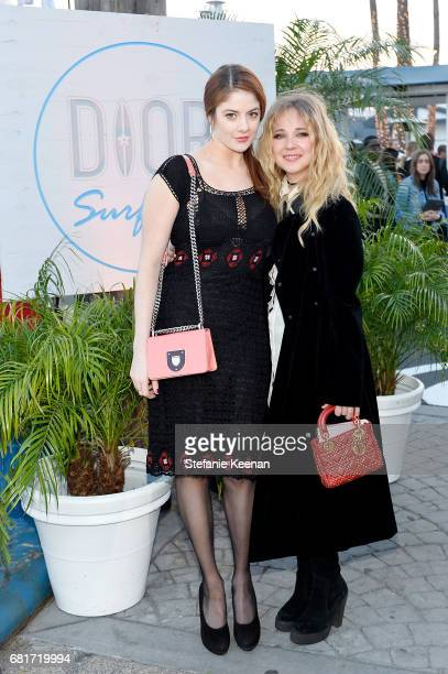 Emily Tremaine and Juno Temple attend Christian Dior Cruise 2018 Welcome Dinner at Gladstone's Malibu on May 10 2017 in Malibu California