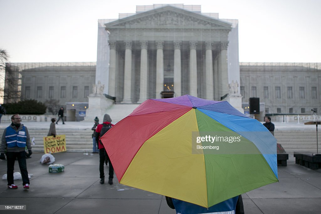 Emily Van Dusen holds a rainbow colored umbrella outside the U.S. Supreme Court in Washington, D.C., U.S., on Tuesday, March 26, 2013. The Supreme Court takes up what is probably its biggest civil-rights dispute in decades this week when it hears arguments that could lead to the legalization of same-sex marriage nationwide. Photographer: Andrew Harrer/Bloomberg via Getty Images
