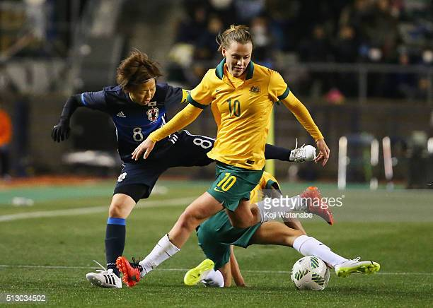 Emily van Egmond of Australia and Aya Miyama of Japan compete for the ball during the AFC Women's Olympic Final Qualification Round match between...