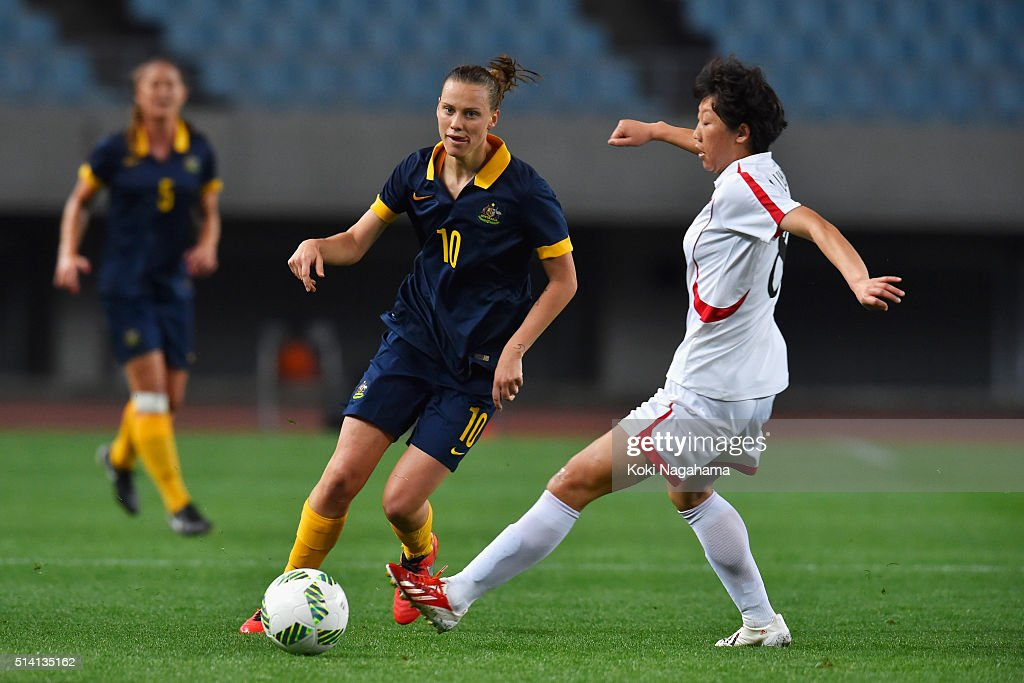 Emily van Egmond of Australia and Kim Un Ju of North Korea compete for the ball during the AFC Women's Olympic Final Qualification Round match...