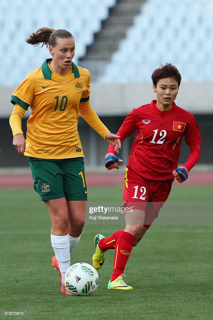 Emily van Egmond of Australia and Pham Hai Yen of Vietnam compete for the ball during the AFC Women's Olympic Final Qualification Round match between...