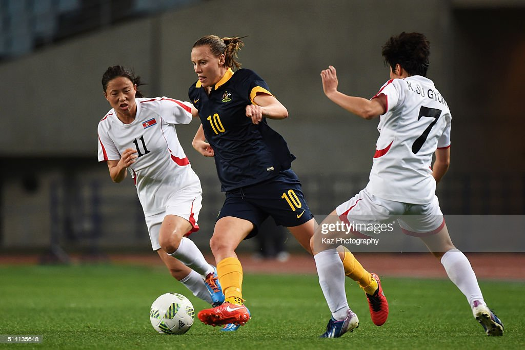 Emily van Egmond of Australia competes for the ball against Ri Ye Gyong and Kim Su Gyong of North Korea during the AFC Women's Olympic Final...