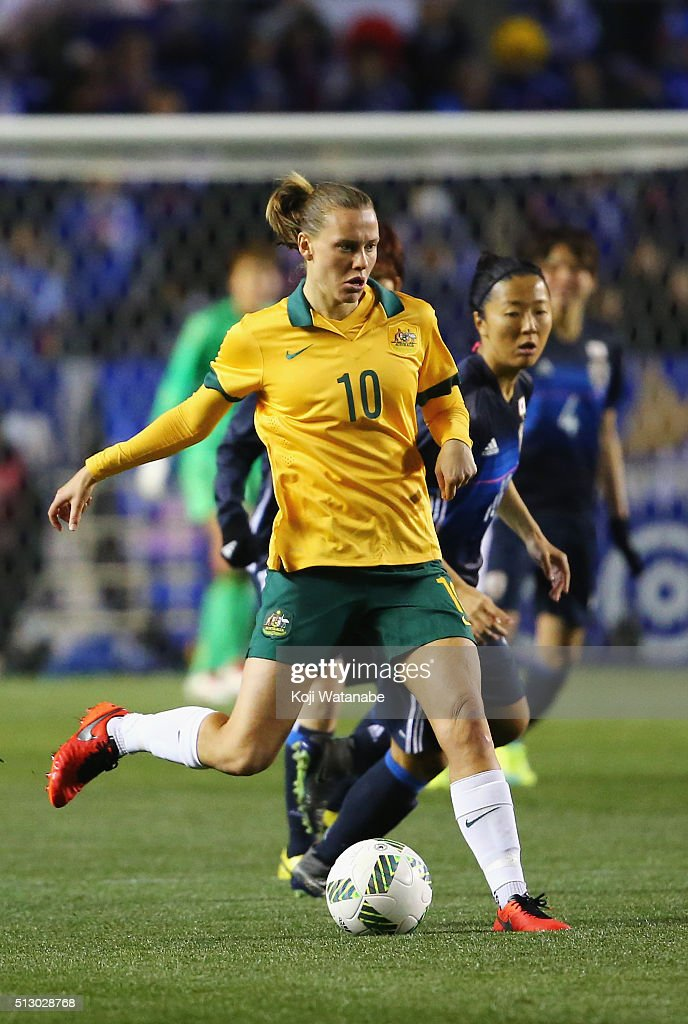 Emily van Egmond of Australia controls the ball under pressure of Yuki Ogimi of Japan during the AFC Women's Olympic Final Qualification Round match...