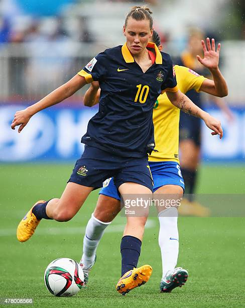 Emily van Egmond of Australia evades Thaisa of Brazil during the FIFA Women's World Cup 2015 round of 16 match between Brazil and Australia at...