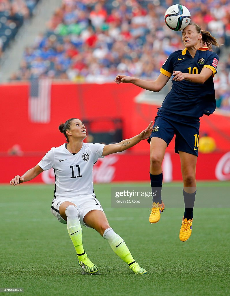 Emily Van Egmond of Australia heads the ball against Alex Krieger of United States in the second half during the FIFA Women's World Cup 2015 Group D...
